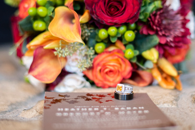 Wedding rings at fall wedding near Asheville at The Lodge at Flat Rock