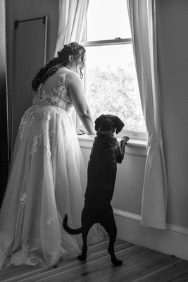 Bride and dog getting ready at The Asheville Masonic Temple