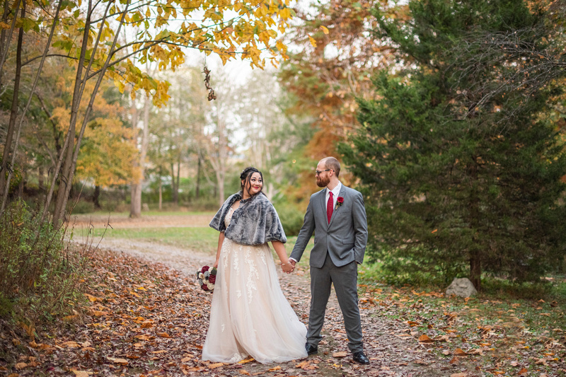 Bride and groom during fall wedding photos at Asheville Botanical Gardens