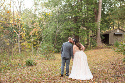 Bride and groom kissing at Botanical Gardens in Asheville