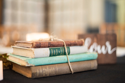 Wedding centerpiece with vintage books at Celine and Company in Asheville