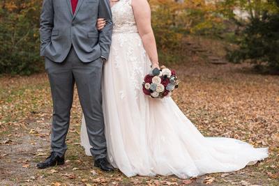 Wedding dress and tuxedo details at Botanical Gardens in Asheville
