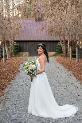 Bridal portrait in front of alpaca barn at Hawkesdene in Andrews NC