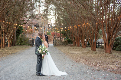Bride and groom portrait at fall wedding at Hawkesdene in Andrews NC