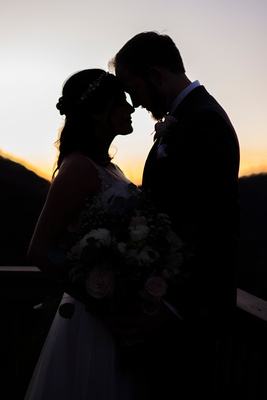 Bride and groom silhouette photo on mountain top at Hawkesdene in Andrews NC