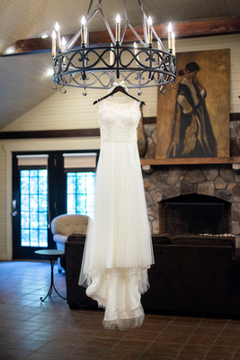 lace top wedding dress hanging at Hawkesdene in fall