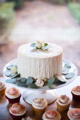 Simple wedding cake with greenery at Hawkesdene wedding in Andrews