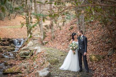 Wedding photo by creek at Hawkesdene in Andrews NC