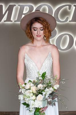 Bride holding flower bouquat at The Shamrock Room in Brevard NC