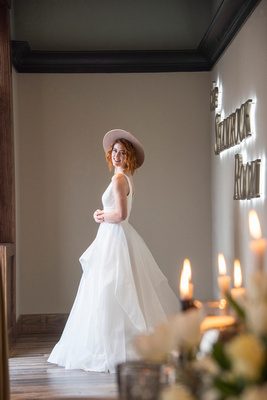 Bride in wedding dress at The Shamrock Room in downtown Brevard NC near Asheville