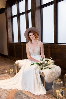 Bride sitting for portrait at The Shamrock Room in Brevard NC near Asheville
