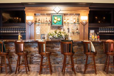 The Shamrock Room bar area at wedding venue in Brevard