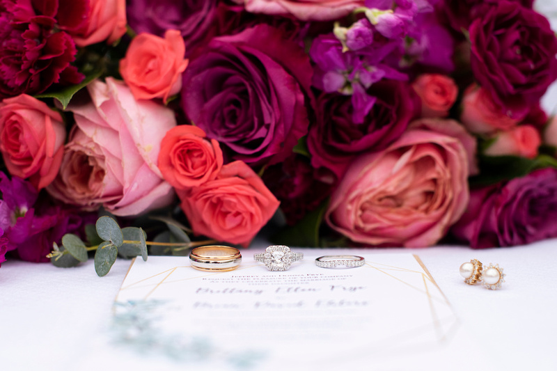 The Foundry Hotel in Asheville wedding detail photography, wedding rings, invitation, and bouquet