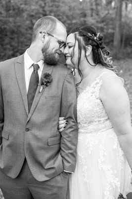 Bride and groom in black and white at Botanical Gardens in Asheville