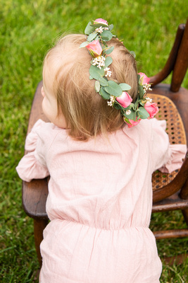 One year baby girl with flower crown at The NC Arboretum in Asheville