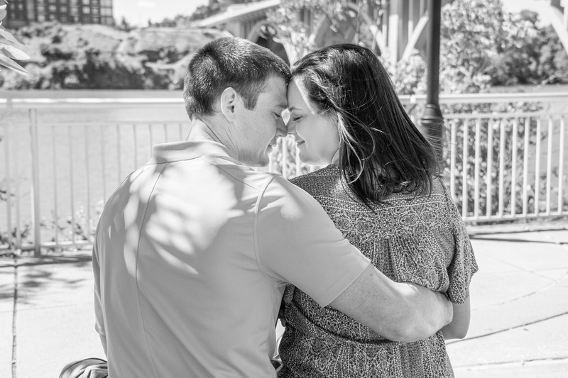 Engagement photo with man and woman touching noses at Volunteer Landing in Knoxville