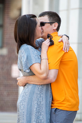 Man and woman kissing at Neyland Stadium in Knoxville after proposal