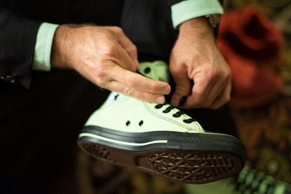 Groom tieing shoe at The Esmeralda Inn Chimney Rock