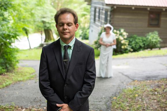 Wedding first look outside at The Esmeralda Inn Chimney Rock