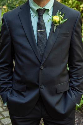 Grooms suit at The Esmeralda Inn Chimney Rock wedding