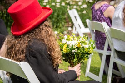Bride's son holding bouquet at The Esmeralda Inn Chimney Rock