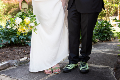 Bride and groom showing shoes at The Esmeralda Inn Chimney Rock