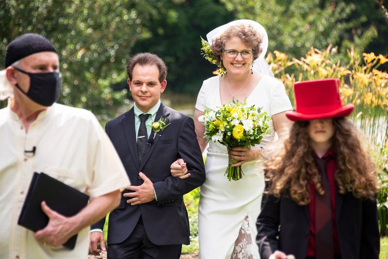 Wedding ceremony precessional at The Esmeralda Inn Chimney Rock