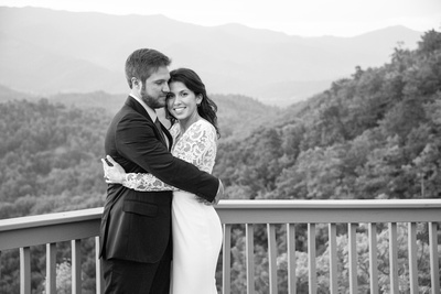 Bride and groom in black and white on mountain top after wedding at Hawkesdene in Andrews near Asheville