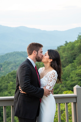 Bride and groom kissing on top of mountain at Hawkesdene in Andrews near Asheville