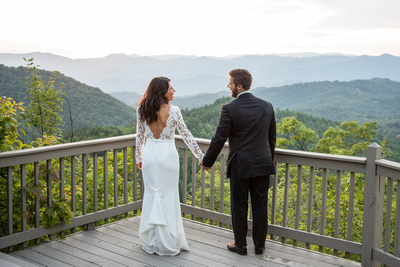 Bride and groom looking at mountains at Hawkesdene in Andrews near Asheville