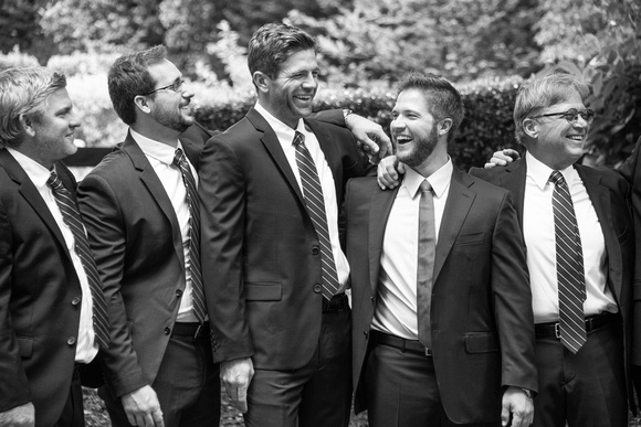 Groom laughing with groomsmen at Hawkesdene in Andrews near Asheville in summer