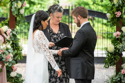 Ring exchange during wedding ceremony at Hawkesdene in Andrews near Asheville