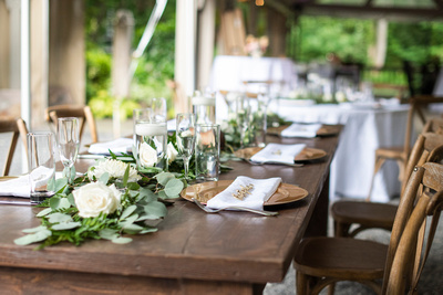 Table settings at summer wedding at Hawkesdene in Andrews near Asheville