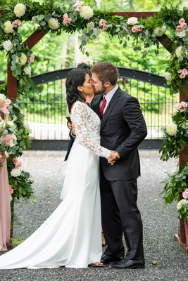 Wedding ceremony first kiss at Hawkesdene in Andrews near Asheville