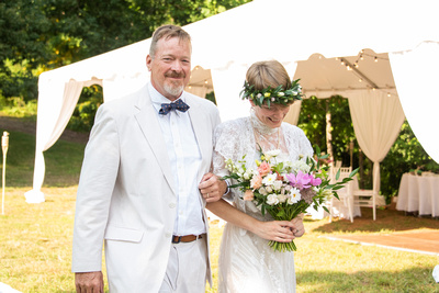 Bride and her father walking down the aisle at outdoor wedding at Engadine Inn in Asheville