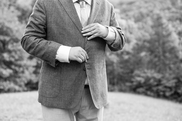 Groom getting ready for wedding at Engadine Inn in Asheville