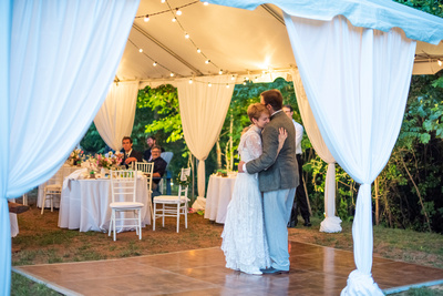 Outdoor wedding reception with tent at Engadine Inn in Asheville