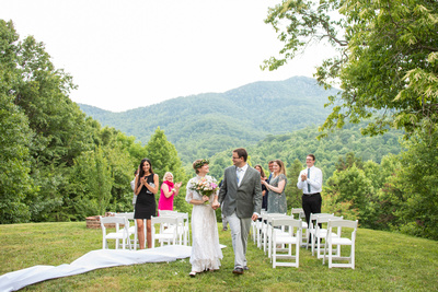 Wedding ceremony recessional at open air wedding at Engadine Inn in Asheville