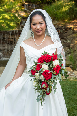 Bridal portrait at The Lodge at Flat Rock wedding in front of waterfall