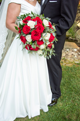 Bride and groom detail photo with bouquet at The Lodge at Flat Rock wedding