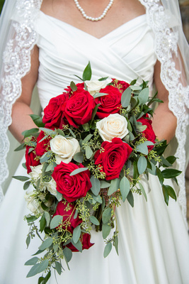 Red and white rose wedding bouquet at The Lodge at Flat Rock in Hendersonville