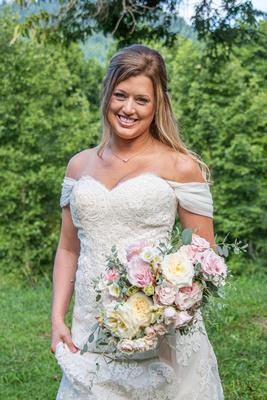 Bridal portrait with bride walking at Engadine Inn Wedding in Asheville