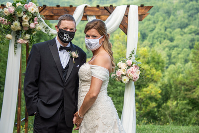 Bride and groom in facemasks at Engadine Inn Wedding in Asheville