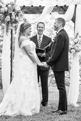 Bride and groom laughing during ceremony at Engadine Inn Wedding in Asheville