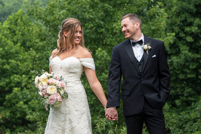 Bride and groom smiling at one another at Engadine Inn Wedding in Asheville