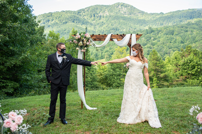 Bride and groom social distancing at Engadine Inn Wedding in Asheville