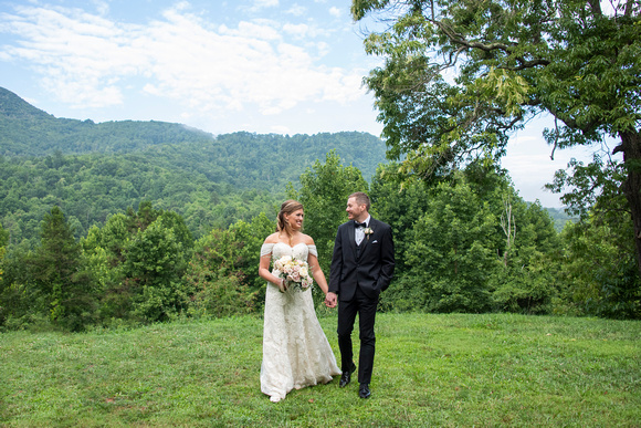 Bride and groom walking with mountain view Engadine Inn Wedding in Asheville
