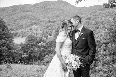 Groom nuzzling bride at Engadine Inn Wedding in Asheville