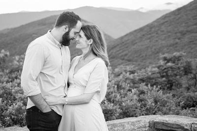 Man and woman at Craggy Pinnacle with mountain views