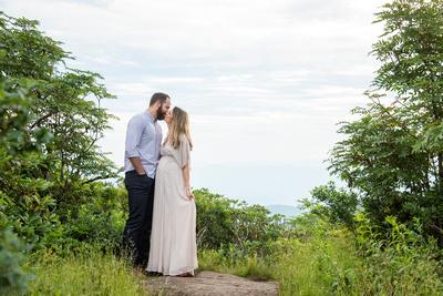 Man and woman kissing during maternity photos at Craggy Pinnacle